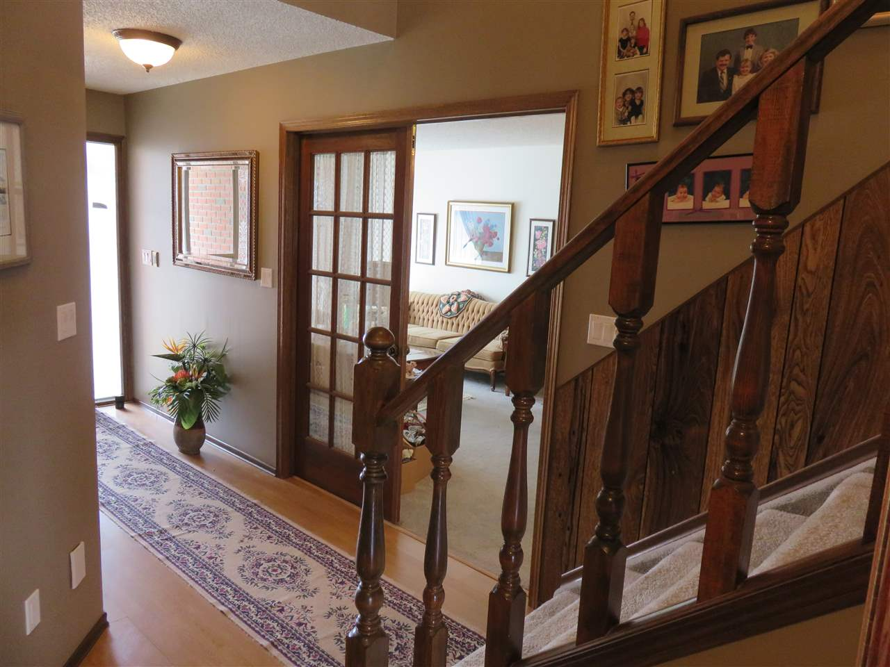 View of the front entrance & Staircase! Note the French Doors that close off the Formal Living Room!
