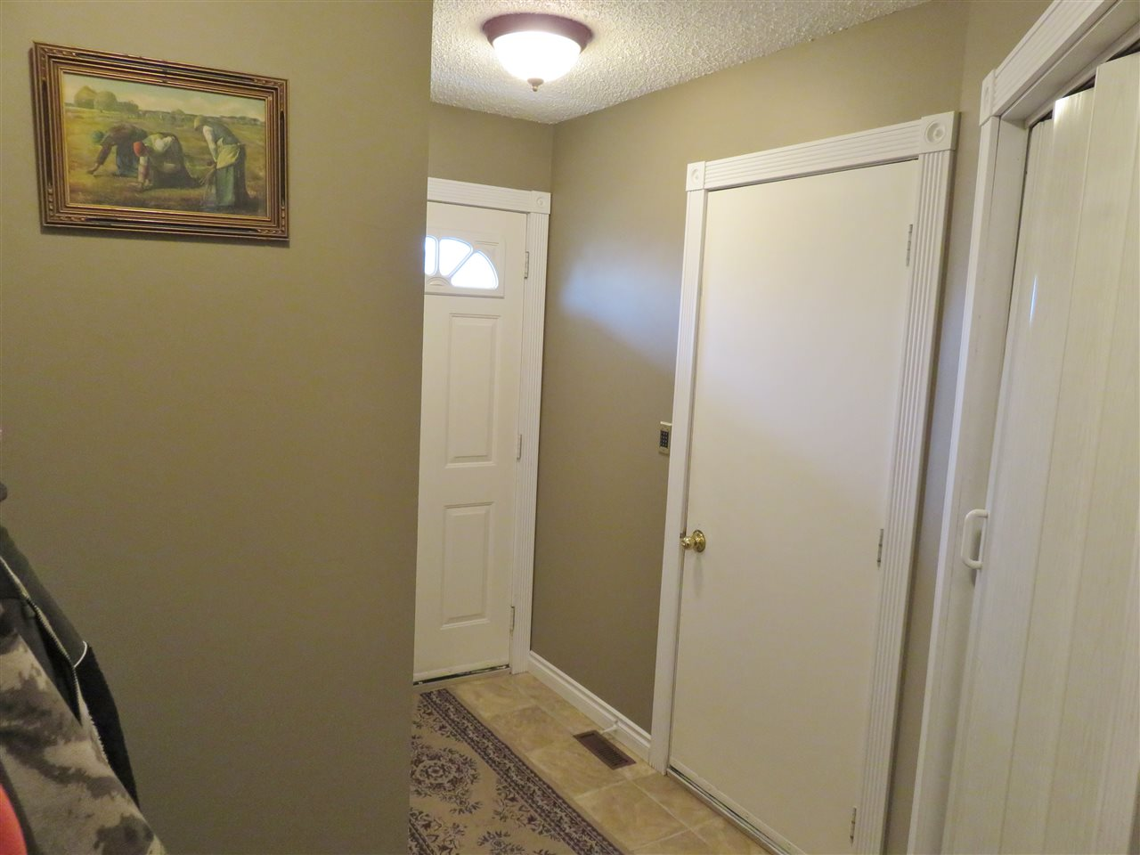 Here is the Laundry Room area located by the Garage entrance door! Note there is also a side door to the backyard! :)