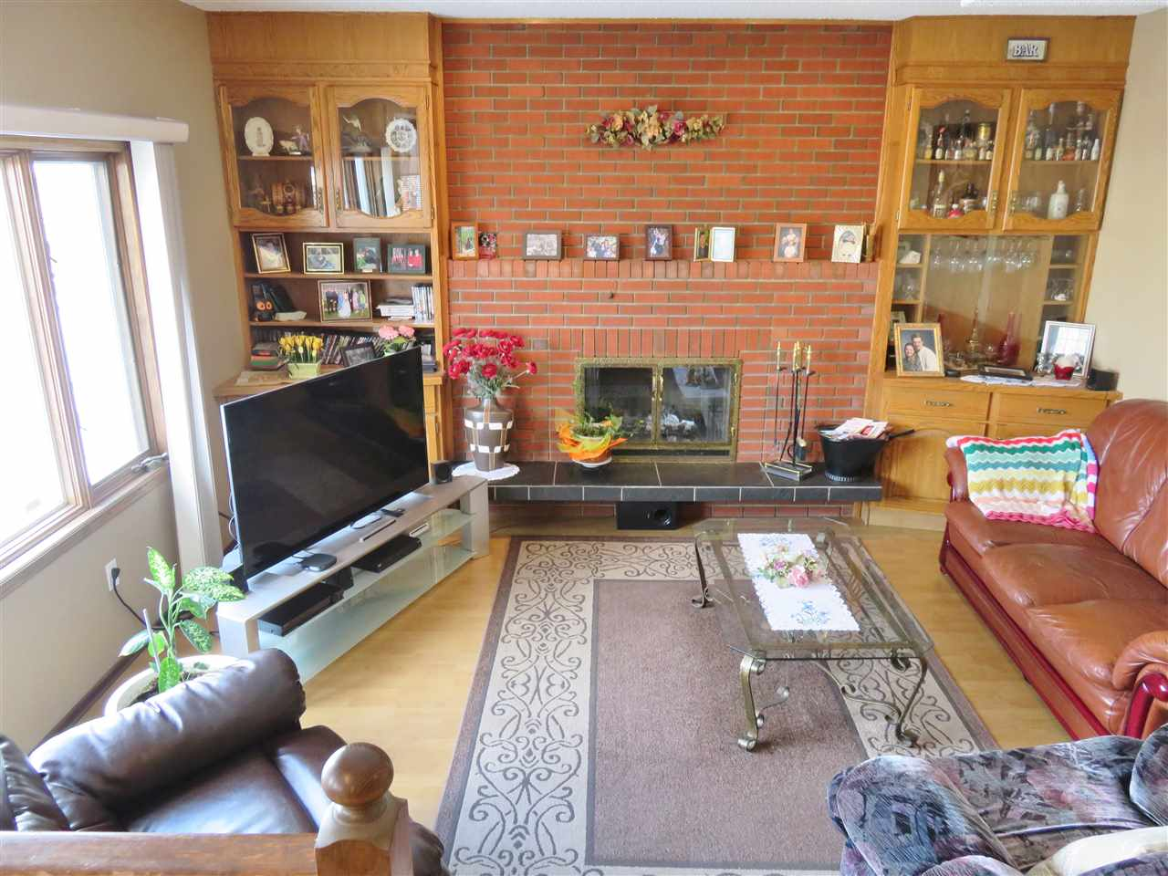 View of the Sunken Family Room! Note the Brick Wood Burning Fireplace too! :)