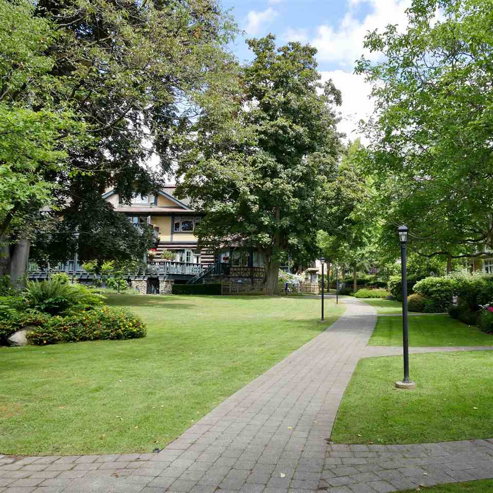 "Main Photo: 883 W 59TH Avenue in Vancouver: South Cambie Townhouse for sale in ""CHURCHIL GARDENS"" (Vancouver West)  : MLS® # R2192541"