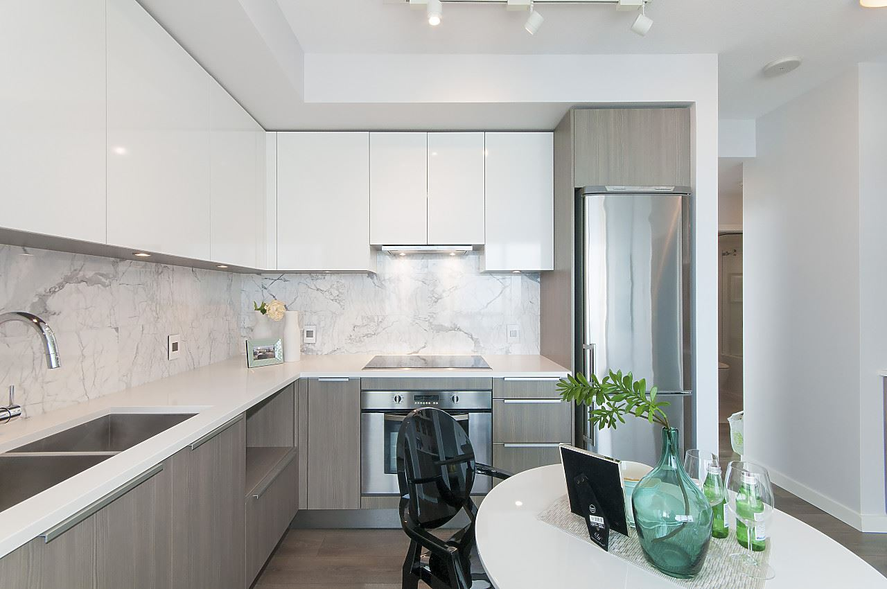 Marble backplash, Eggersmann soft closing cabinets, quartz counters, Grohe faucet.