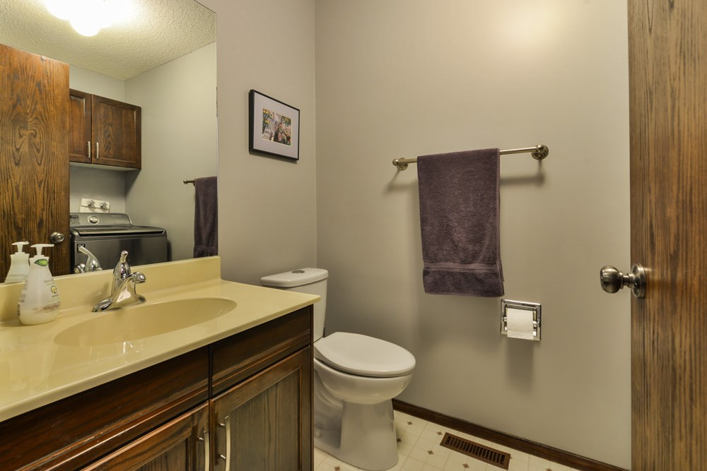 Main floor bathroom, with laundry area.  Newer washer and dryer.