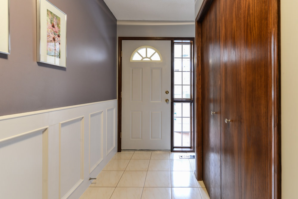 Ceramic tile, wainscoting. Neutral paint color throughout.