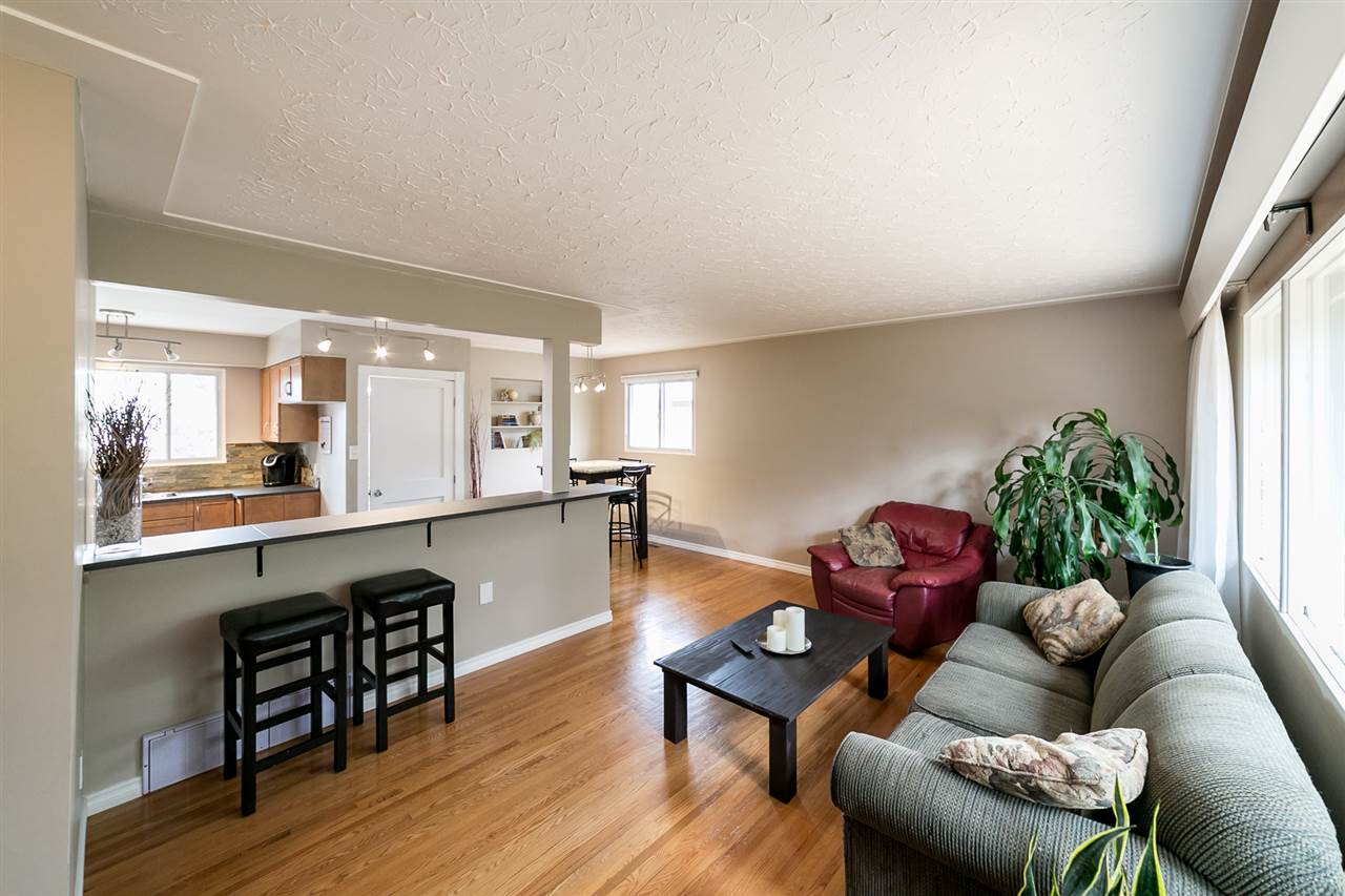 Living rooom is bright and spacious and is open concept to the kitchen - very modernized!