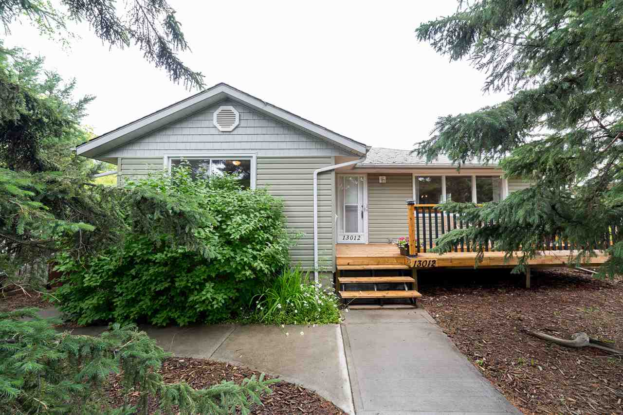 Treed front yard offers privacy while enjoying your front deck!