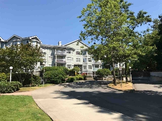 "Main Photo: 104 13955 LAUREL Drive in Surrey: Whalley Condo for sale in ""King George Manor"" (North Surrey)  : MLS® # R2190245"