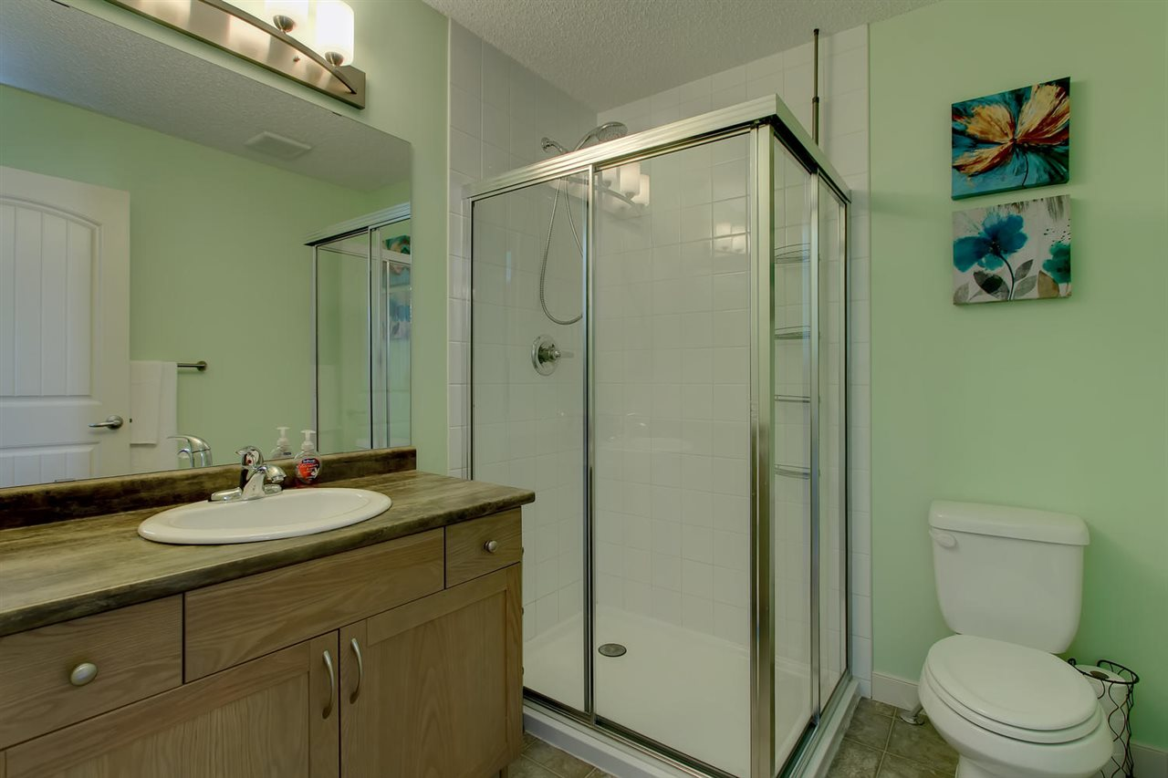 Notice the over-sized shower with full tile surround.