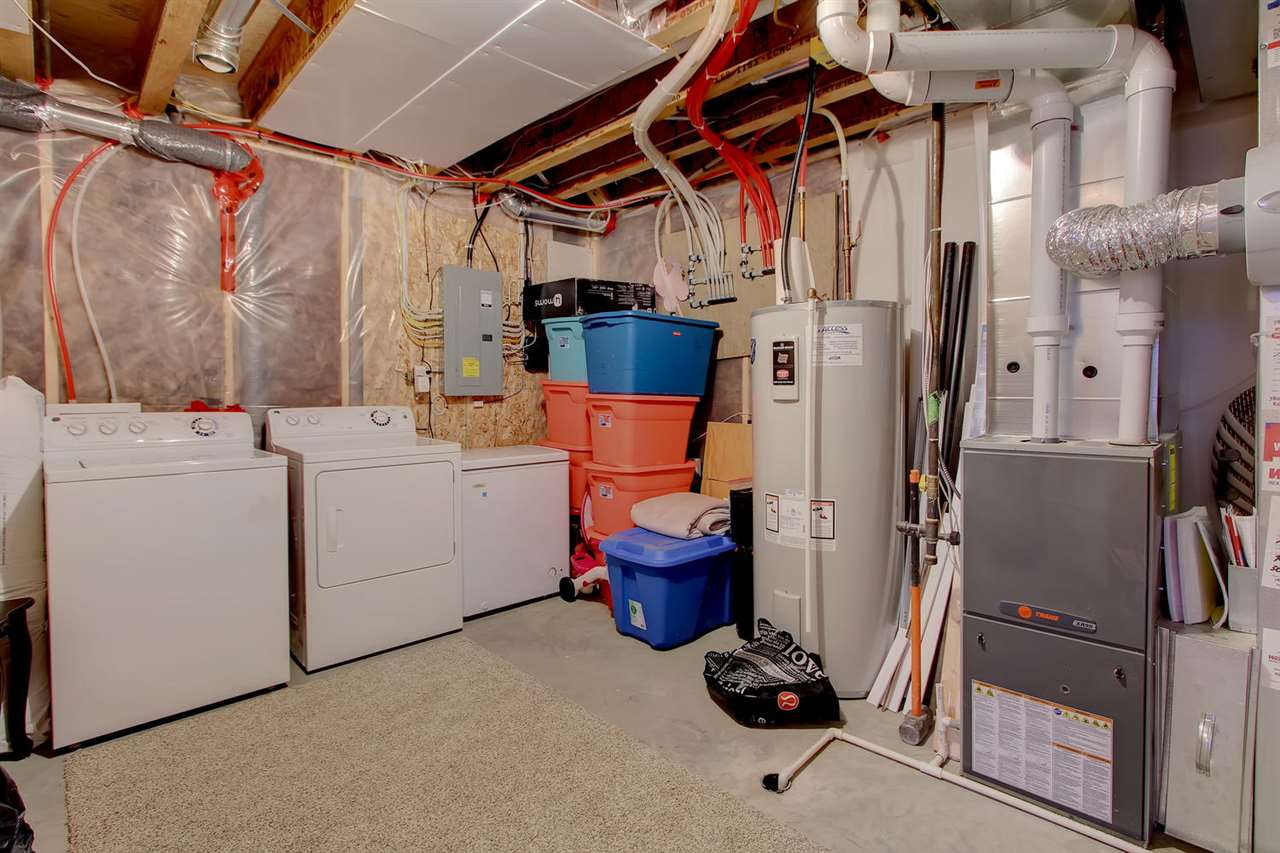 The laundry/utililty/storage area hosts the hi-efficient furnace & 76 gallon water heater. There is also plenty of storage in this area & a separate strorage room.