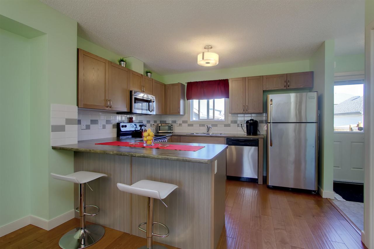 Your functional kitchen offers lots of appealing cabinets & counter top space, designer tile back splash, eating bar peninsula, pantry & stainless steel appliances.