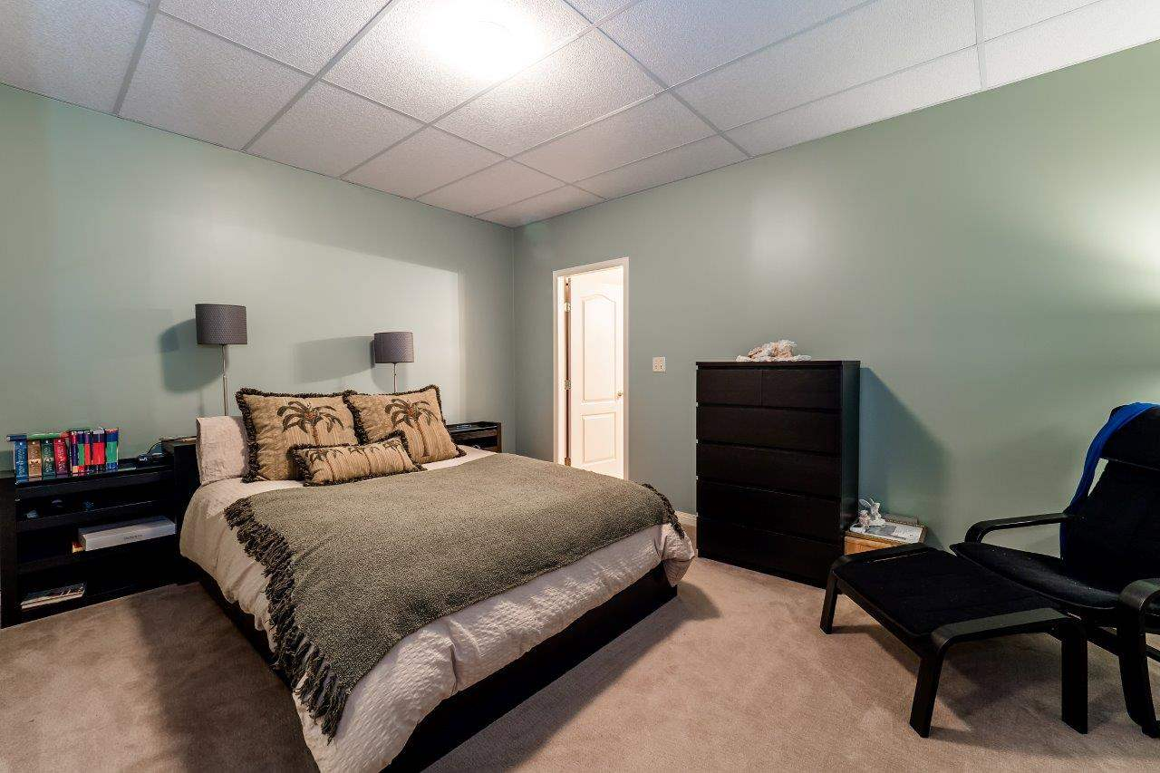 This downstairs bedroom guest room is perfect for extra family or friends with en-suite bath.