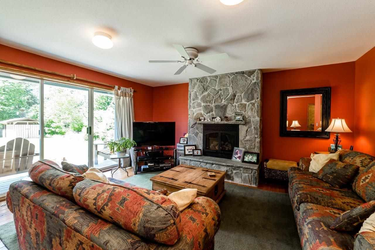 Great room style with access to HUGE rear yard - cozy gas fireplace, rustic plank floors that extend throughout great room, kitchen and living & dining room.