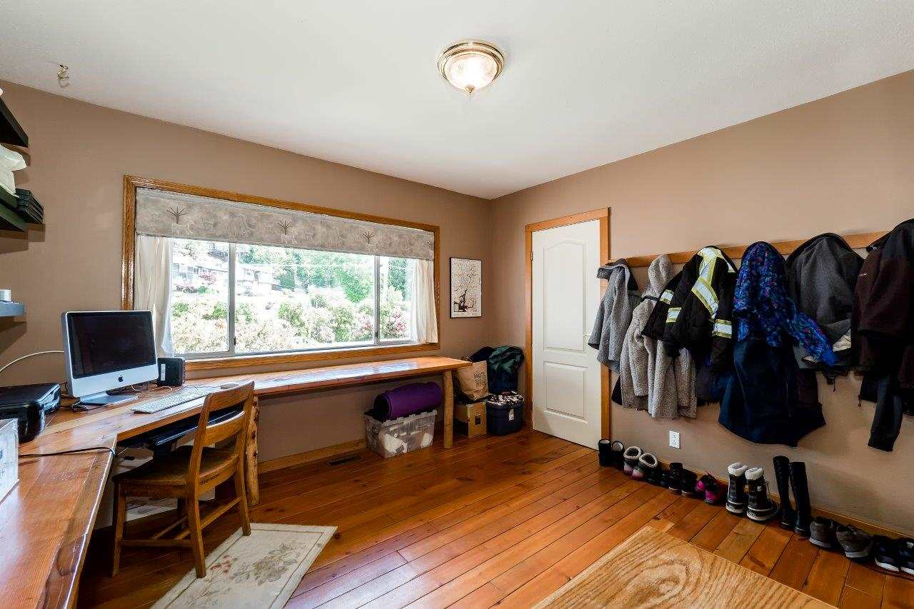 Just of the entry The office or den has a full sized closet and 2nd  access doorway to kitchen family room.