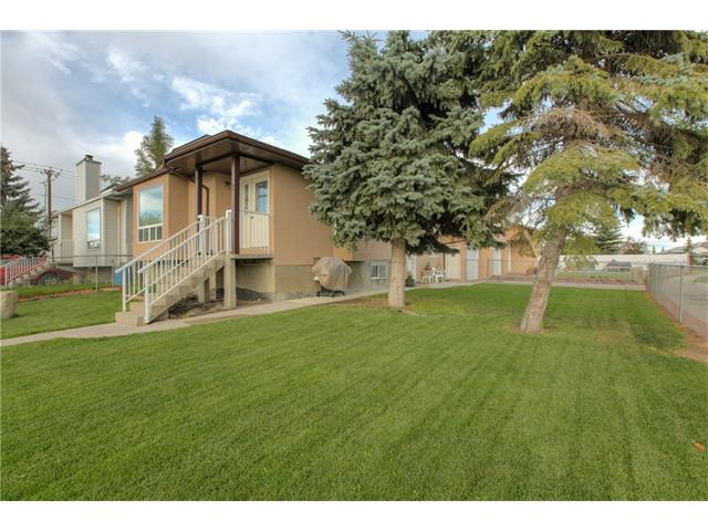 Photo 2: 8 ERIN MEADOWS Court SE in Calgary: Erin Woods House for sale : MLS(r) # C4078378