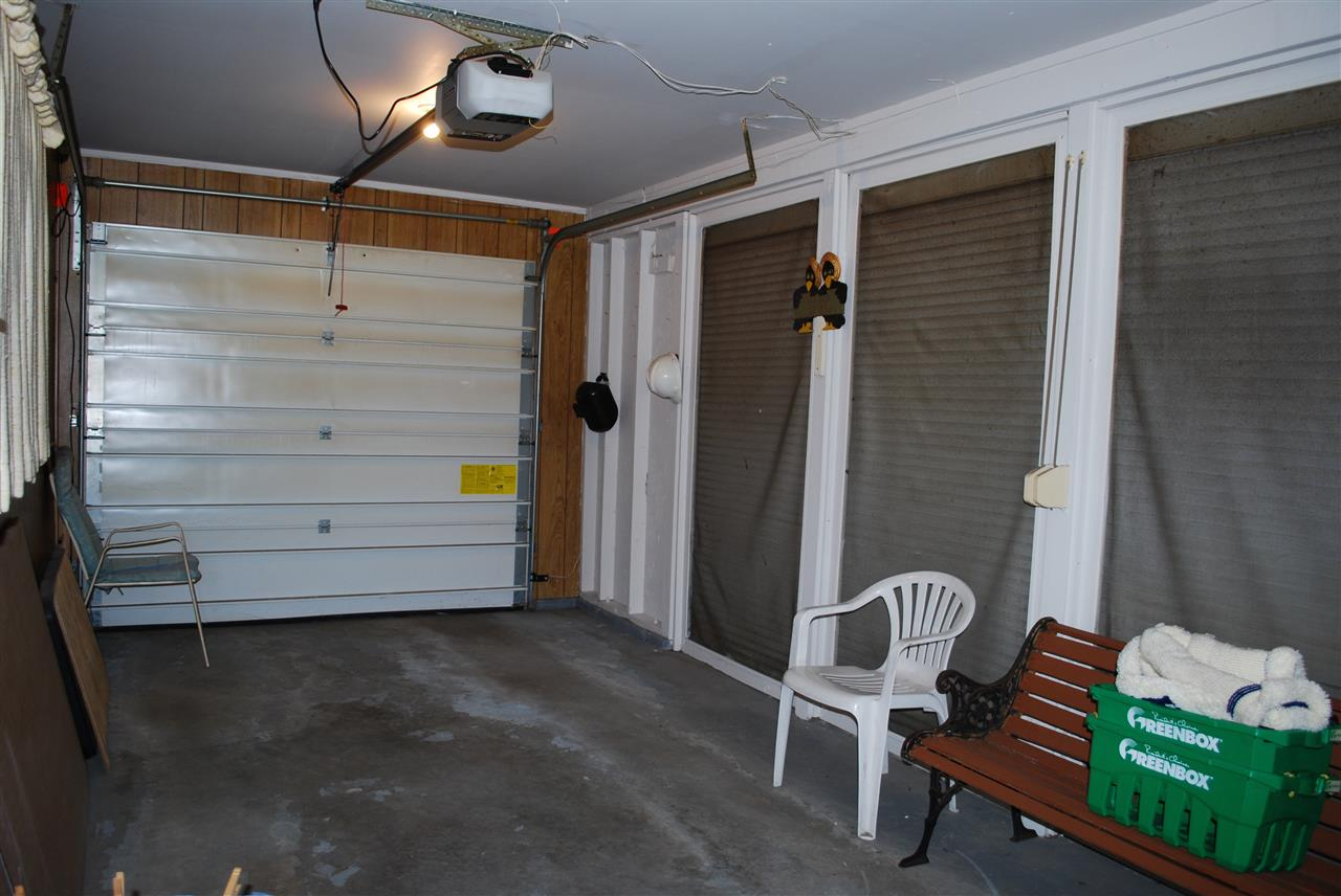 Half of Double Garage used as a summer room.