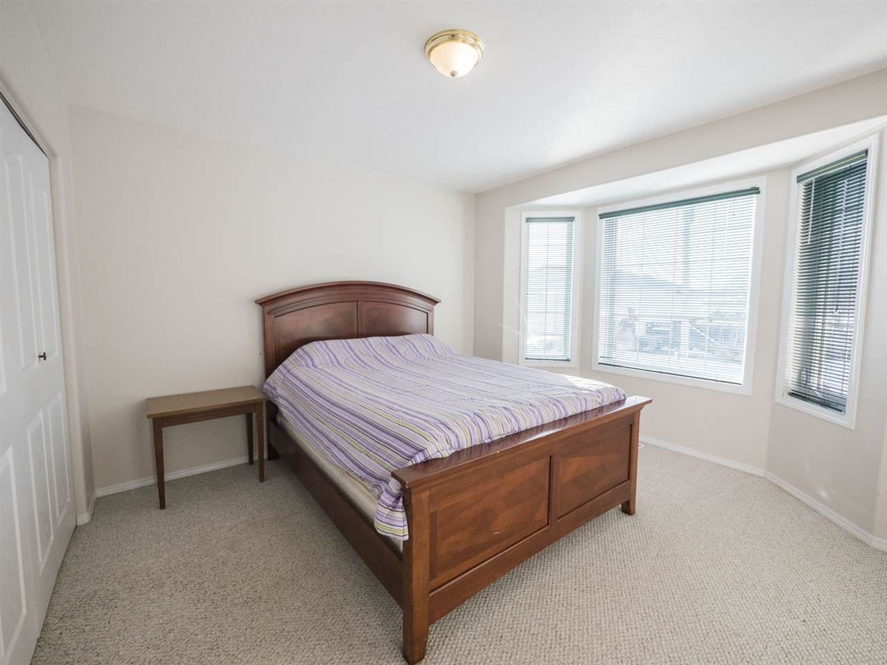 Third bedroom on main level offers a large bow window letting in lots of natural light.