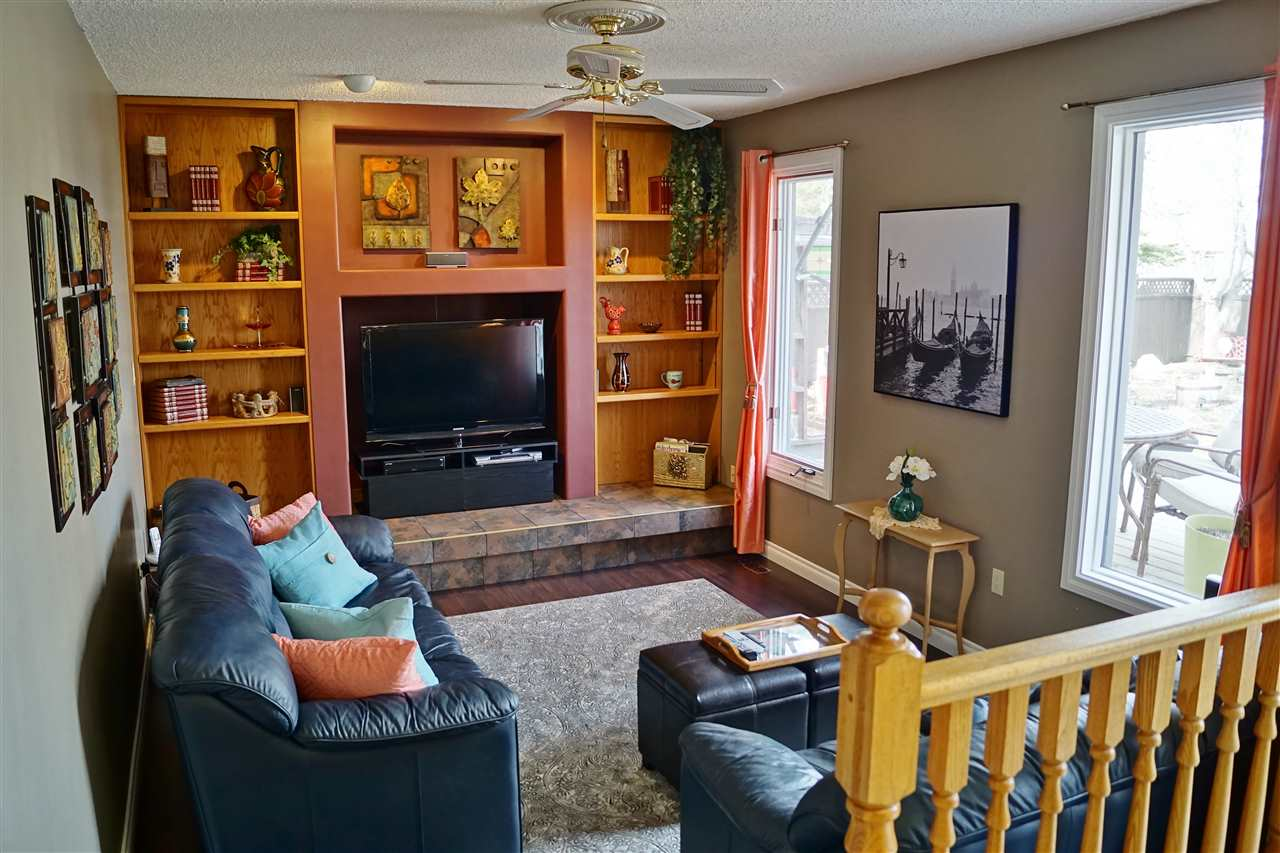 13) Living Room (fireplace can be converted back to wood burning or gas)