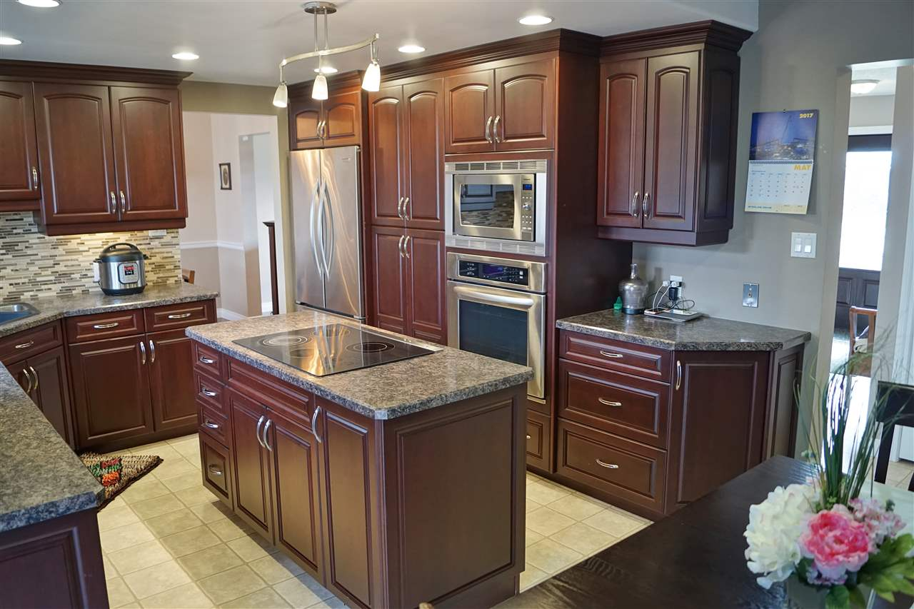 10) Stainless steel appliances contrast the dark cabinetry