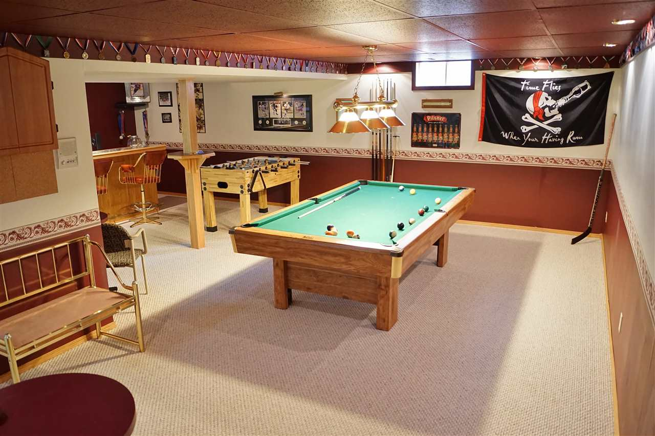 28) Fully finished basement with pool table and bar