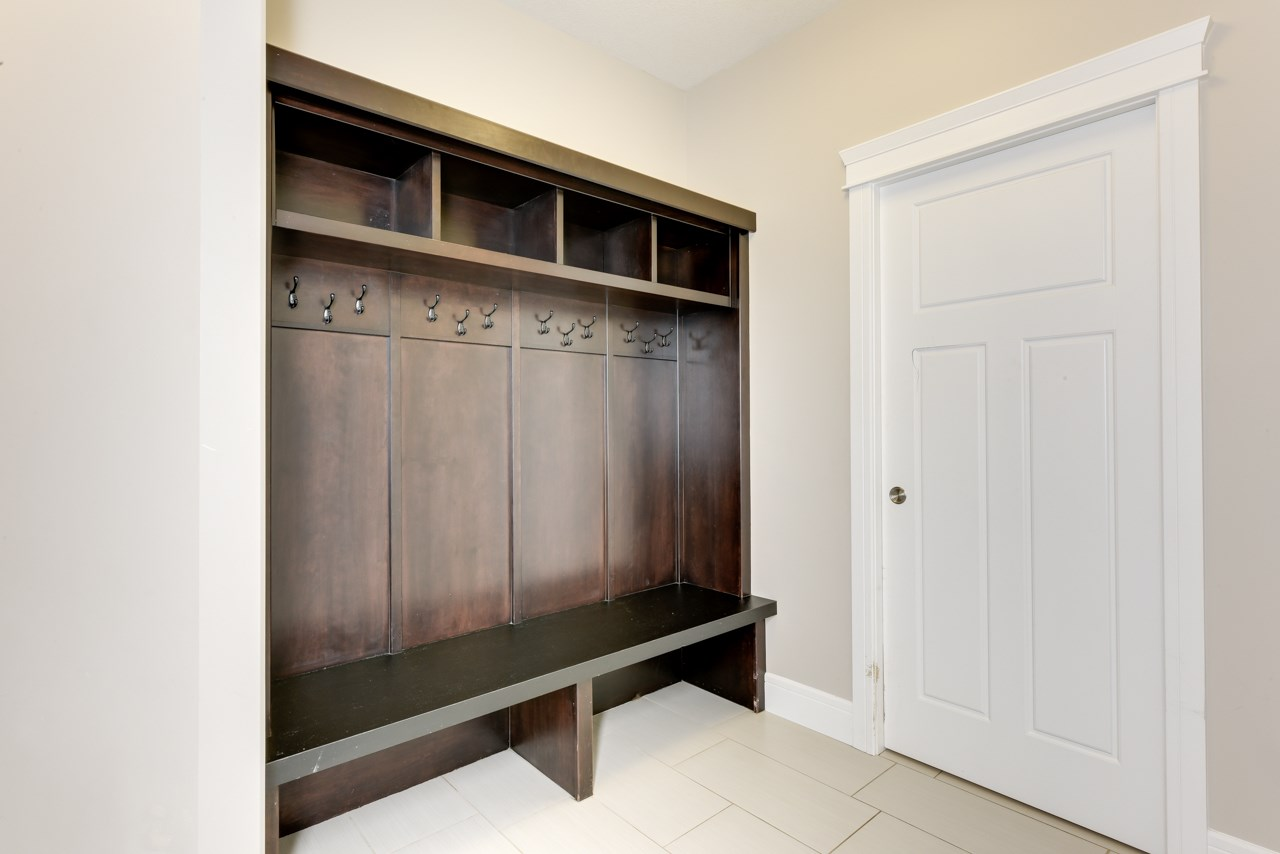 Huge boot room as you enter from the Garage with Beautiful Espresso stained Maple Bench/Coat Rack