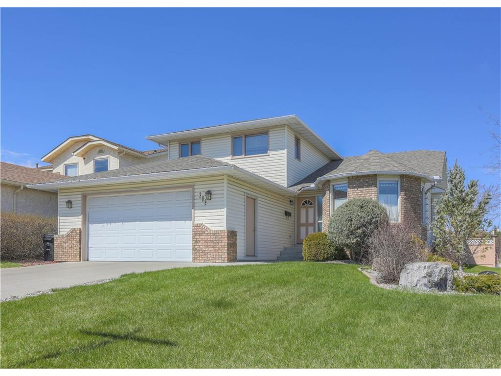 Main Photo: 208 Wood Valley Bay SW: Calgary House for sale : MLS® # c4113660