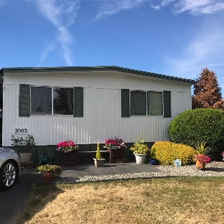 "Main Photo: 2063 CUMBRIA Drive in Surrey: King George Corridor Manufactured Home for sale in ""Cranley Place"" (South Surrey White Rock)  : MLS®# R2199810"