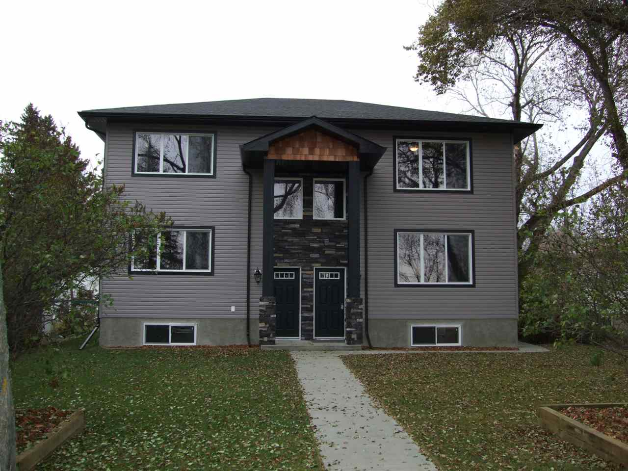 Main Photo: 11246 122 Street in Edmonton: Zone 07 House Duplex for sale : MLS® # E4080054