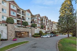 "Main Photo: 304 19677 MEADOW GARDENS Way in Pitt Meadows: North Meadows PI Condo for sale in ""The Fairways"" : MLS®# R2268519"
