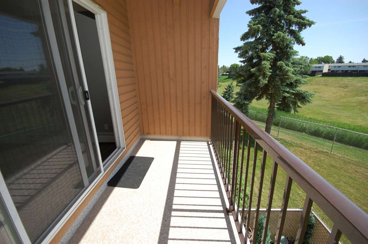 Sunny covered balcony for your enjoyment with Ravine Views.