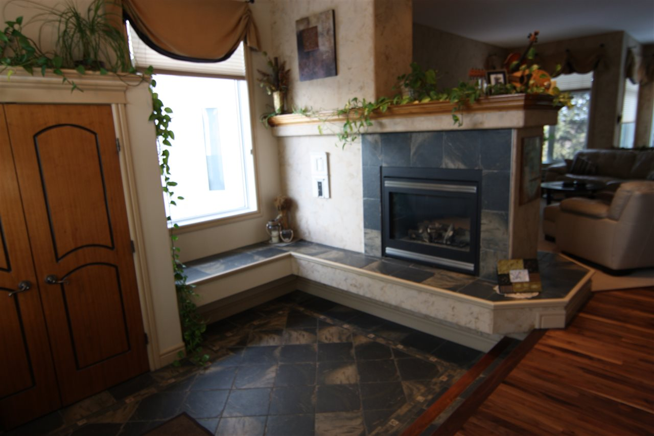 Front entrance features view of 2-sided fireplace