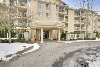 "Main Photo: 210 13727 74 Avenue in Surrey: East Newton Condo for sale in ""Kings Court"" : MLS® # R2128892"