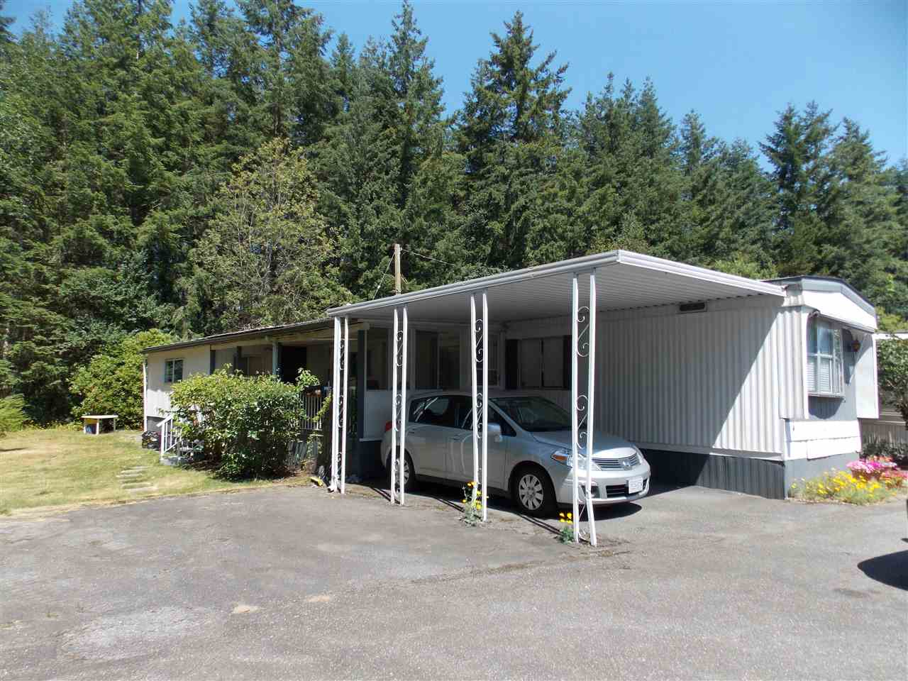"Main Photo: 138 3031 200 Street in Langley: Brookswood Langley Manufactured Home for sale in ""Cedar Creek Mobile Home Park"" : MLS(r) # R2190257"