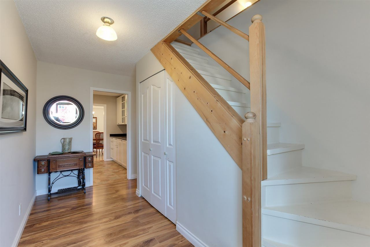 Front entrance w/ stairs up to loft space.