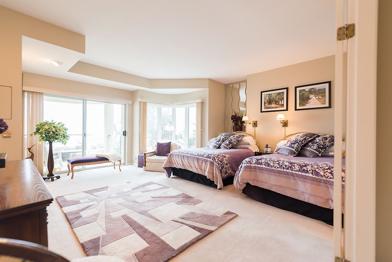 Large master bedroom has fireplace, balcony, great view and ensuite.