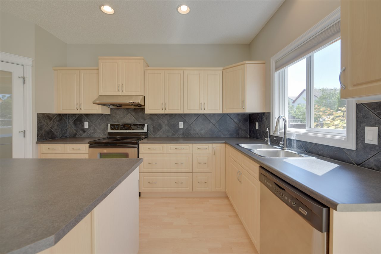 Large Kitchen with Maple Cabinets, S/S Appliances and Walk Thru Pantry and Nook Eating area