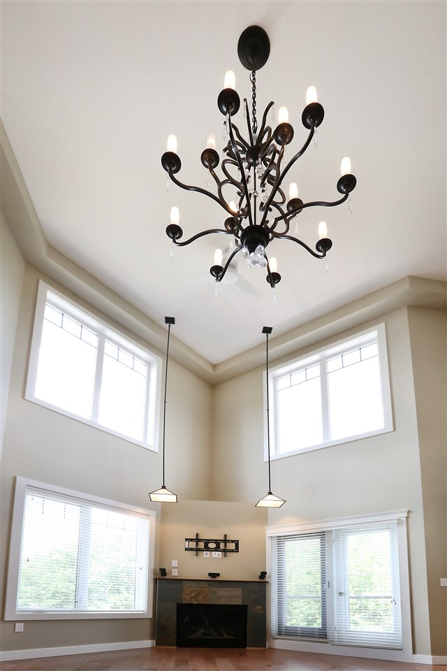 Soaring ceiling in the great room, gas fireplace, large windows