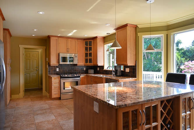 Imagine having your family dinners here! Granite counter tops, updated fixtures and lighting, alder cabinets, stainless stell appliances - natural gas stove top, double sinks, heated floors and more!
