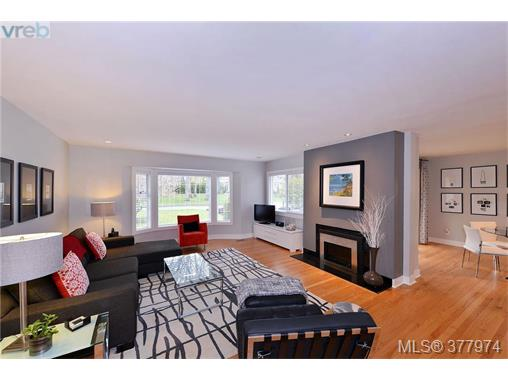 Living Room with gas fireplace, gorgeous hardwood floors.