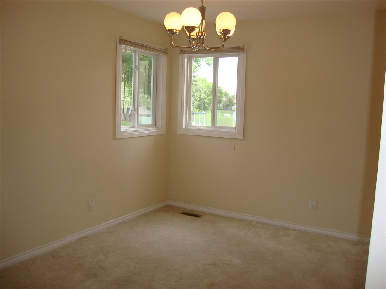Corner windows in dining room add abundant natural light.  Dining room open to kitchen and to living room.