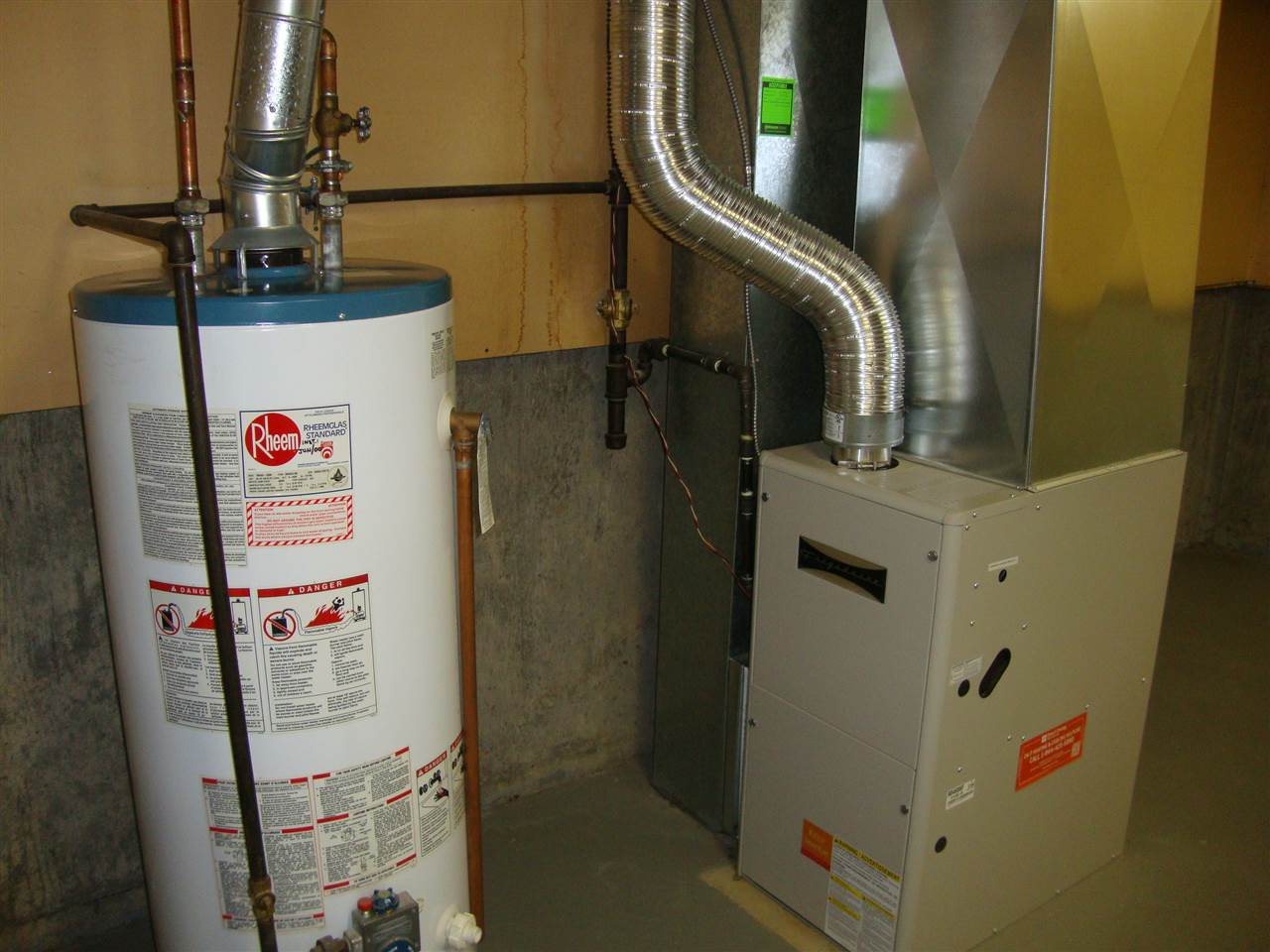Utility area has a newer 2009 mid efficient furnace.