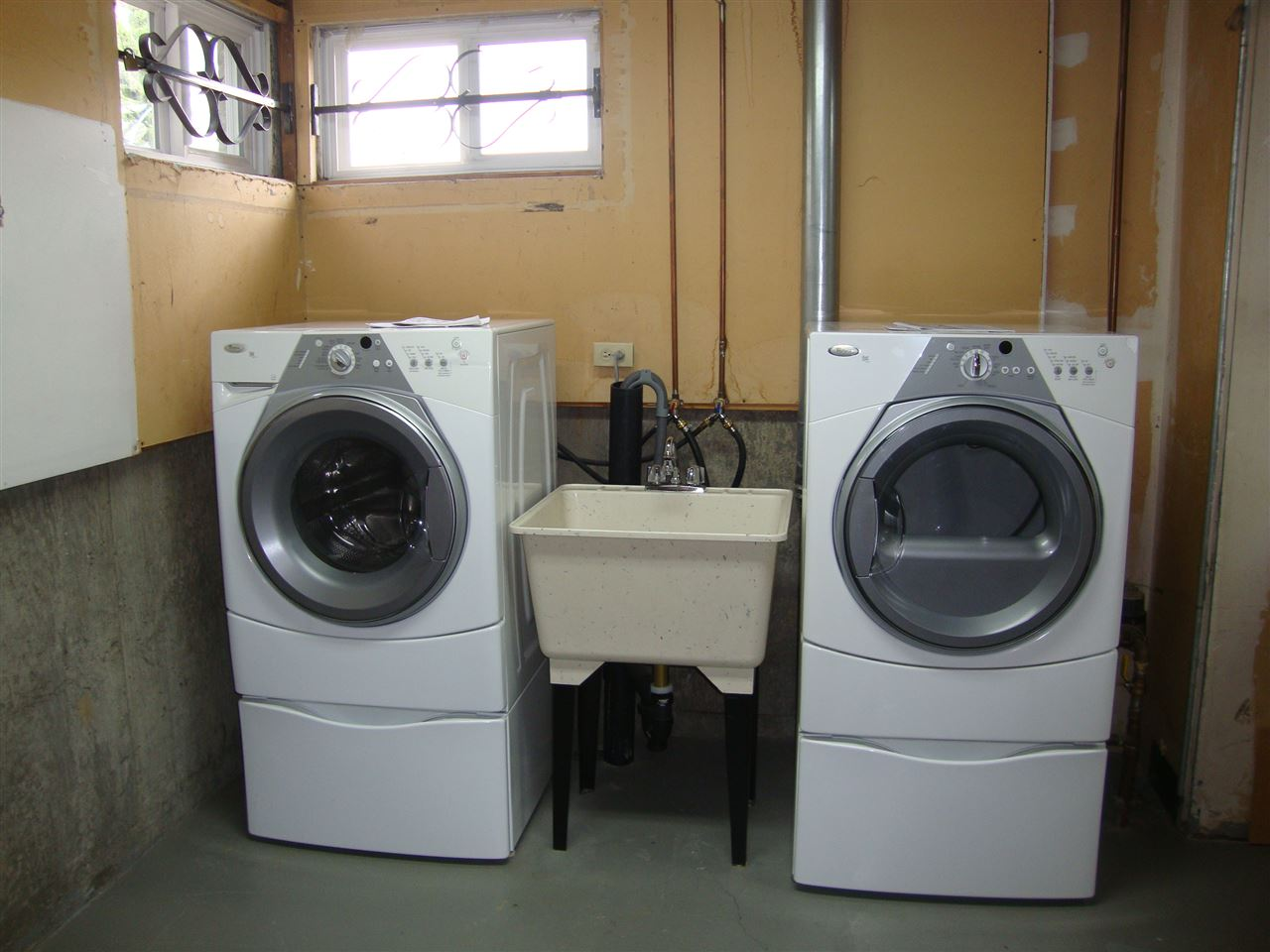 Laundry area in basement includes high efficiency front load washer & dryer, plus built in laundry sink.