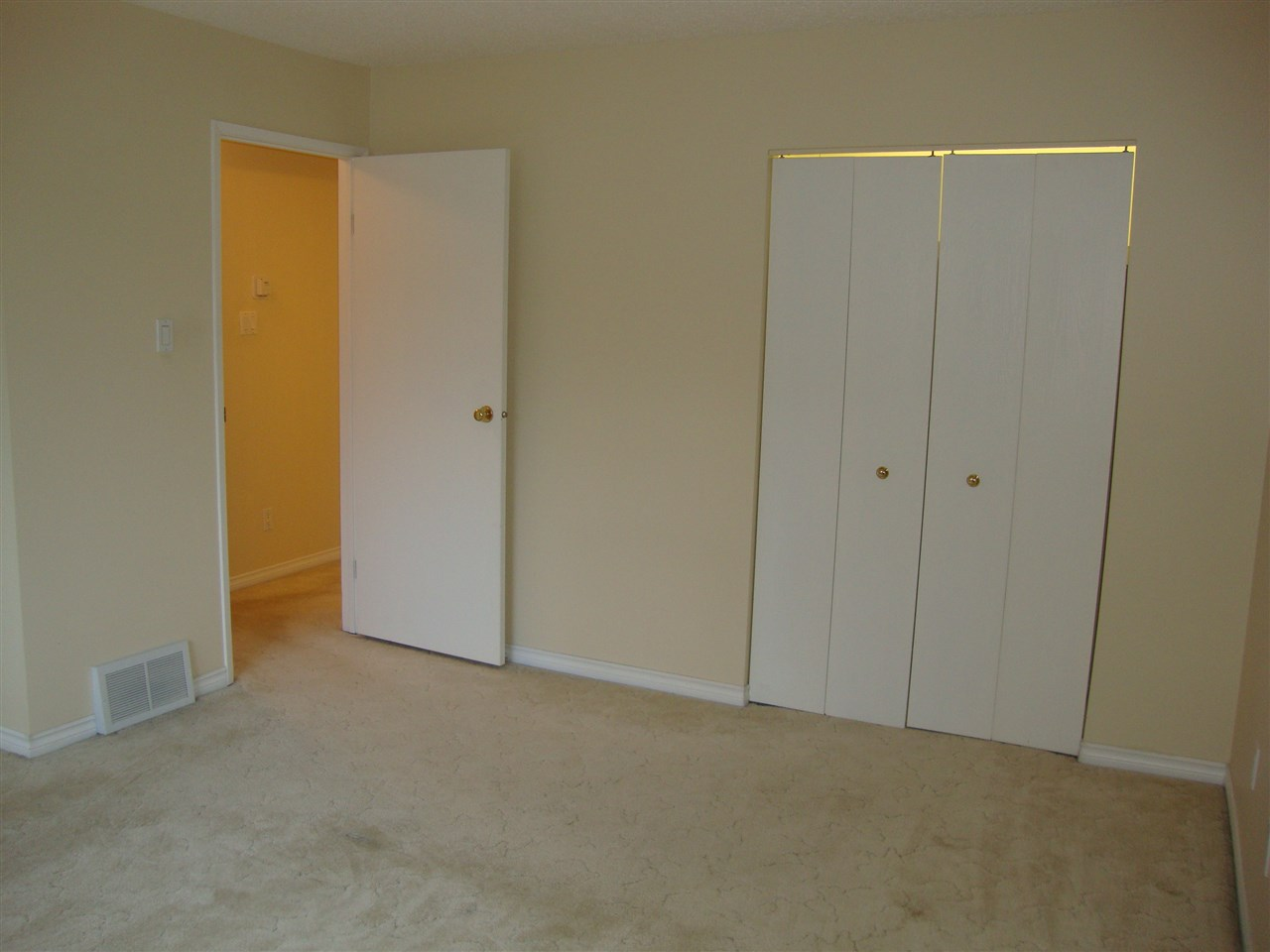 Large master bedroom with lots of room for a king size bed.  Light in closet.