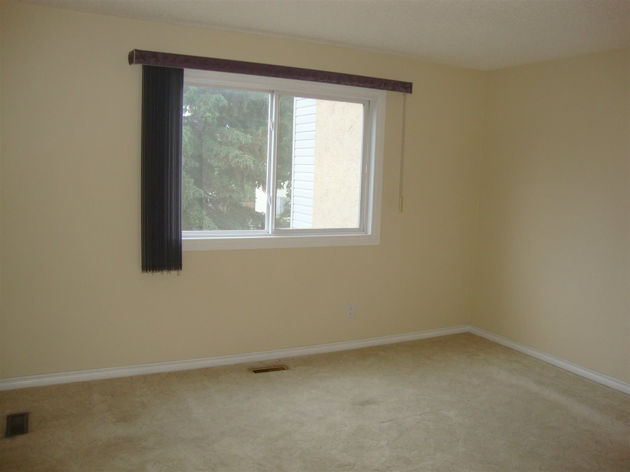 Large master bedroom with lots of room for a king size bed.