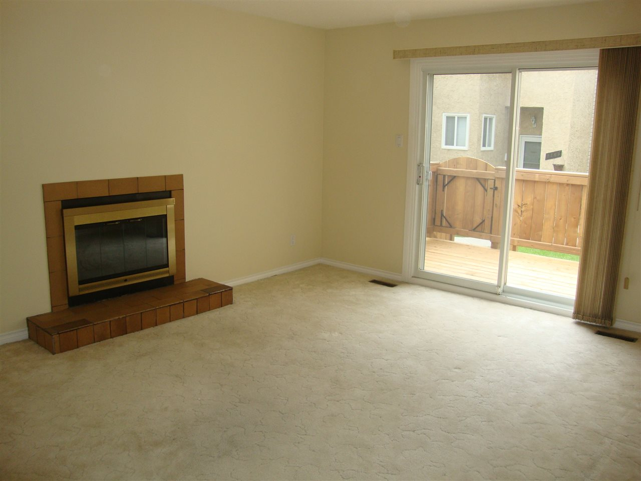 Extra large living room with wood burning FP and newer patio doors to new deck at rear.