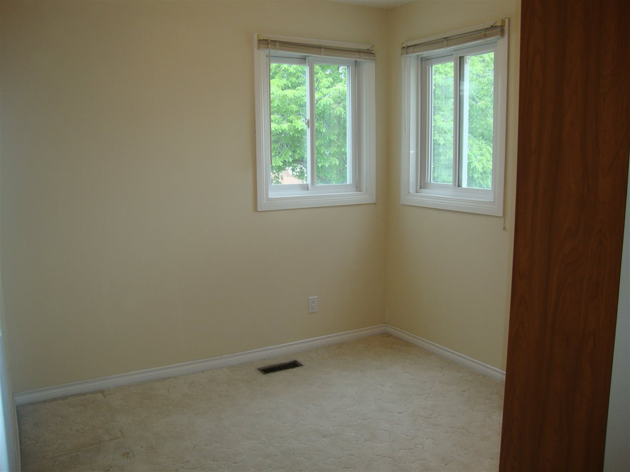 Large bedroom 3 has bright double corner windows, closet and a built in Murphy wall bed.