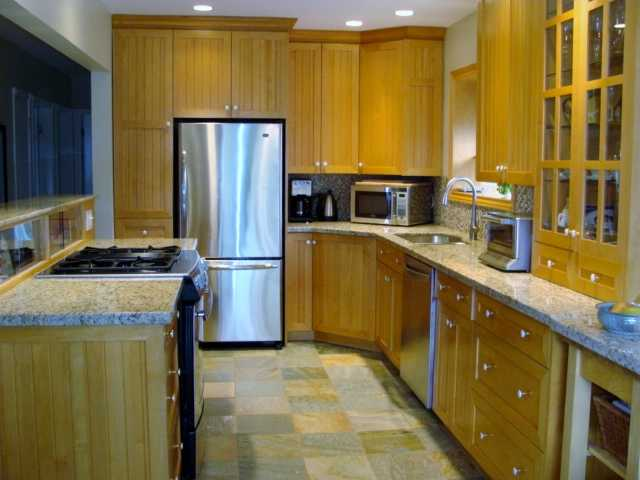 Updated kitchen-stainless steel appliances, recessed lighting, heated tile floors..