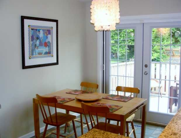 Dining area with french door access to decks