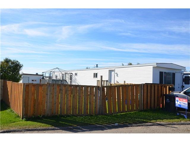 "Main Photo: 48 8420 N ALASKA Road in Fort St. John: Fort St. John - City SE Manufactured Home for sale in ""PEACE COUNTRY MHP"" (Fort St. John (Zone 60))  : MLS® # N230672"