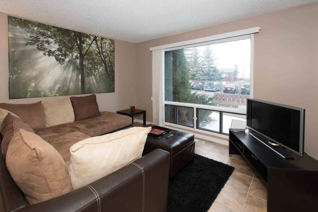 FEATURED LISTING: 113 - 2300 OAKMOOR Drive Southwest CALGARY