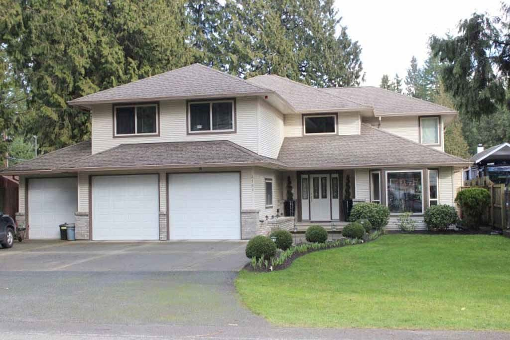 Photo 1: 4188 207 STREET in Langley: Brookswood Langley House for sale : MLS(r) # R2052049