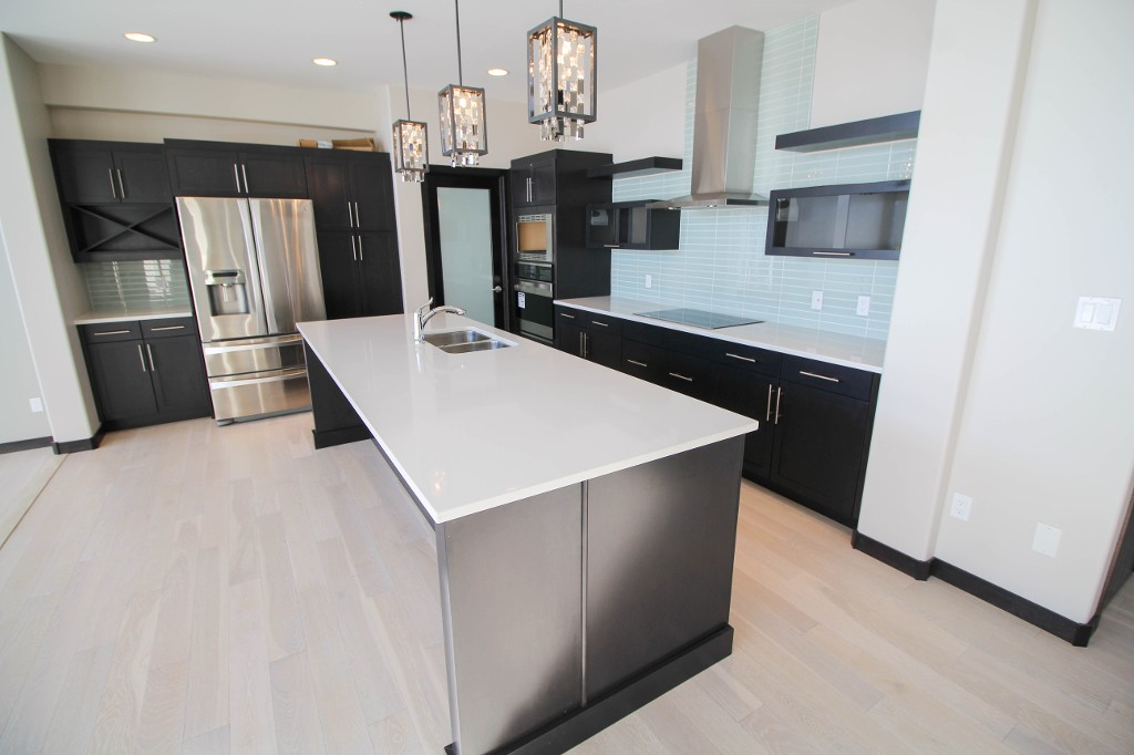 Beautiful dark cabinetry and quartz counter tops